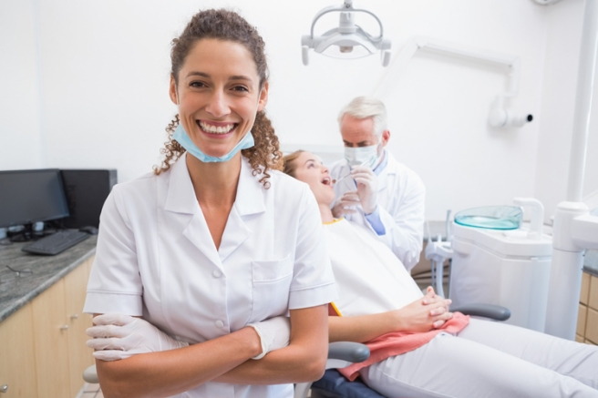 Dental assistant smiling at camera